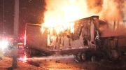 Firefighters battle flames and smoke from an out-of-control truck fire on the Hwy 401 Thursday, March 6, 2014.