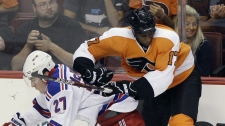 Philadelphia Flyers' Wayne Simmonds, right, and New York Rangers' Ryan McDonagh collide in the third period of a preseason NHL hockey game, Monday, Sept. 26, 2011, in Philadelphia. (AP Photo/Matt Slocum)