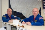 Astronauts Mark Kelly, right, STS-124 commander, and Scott Kelly are pictured in the check-out facility at Ellington Field near NASA's Johnson Space Center in Houston in this undated photo provided by NASA.