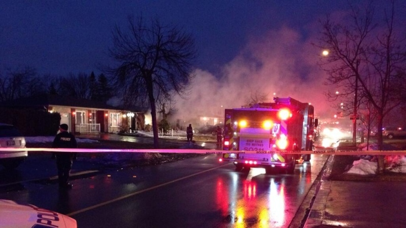 Firefighters attend the scene of a house fire on Goodwood Road in Brampton early Friday, March 28, 2014. (Tom Stefanac / CP24)