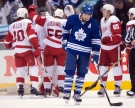 Toronto Maple Leafs left winger Joffrey Lupul skates off the ice as the Detroit Red Wings celebrate after their 4-2 win in NHL action in Toronto on Saturday, March 29, 2014. THE CANADIAN PRESS/Frank Gunn