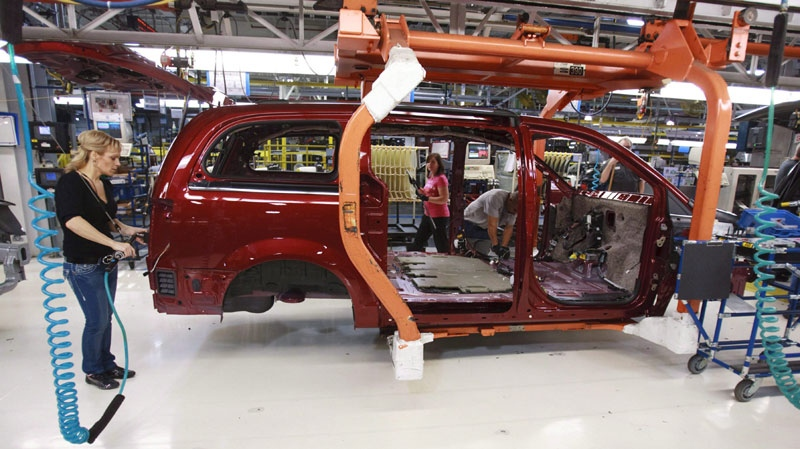 A Chrysler worker is seen on the assembly line at a plant in Windsor, Ont., on Jan. 18, 2011
