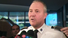 Toronto police Chief Bill Blair speaks to the media police board has voted to approve a new operating budget on Thursday, Oct. 20, 2011.