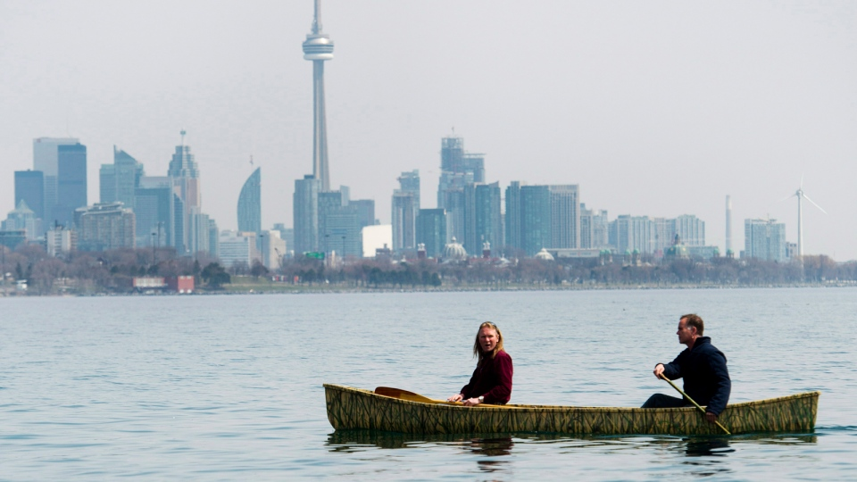 People canoe on Lake Ontario near Humber Bay Park in Toronto on Monday, April 21, 2014. (Nathan Denette / THE CANADIAN PRESS)