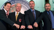 Hockey Hall of Fame inductees, from left to right, Doug Gilmour, Mark Howe, Joe Nieuwendyk and Ed Belfour pose with their rings after being presented with them at the hall in Toronto on Monday Nov. 14, 2011. (Frank Gunn /  THE CANADIAN PRESS)