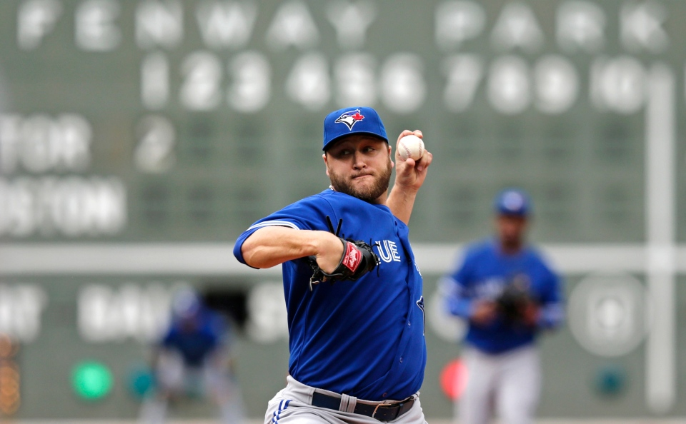 Toronto Blue Jays starting pitcher Mark Buehrle delivers to the Boston Red Sox during the first inning of a baseball game at Fenway Park, Thursday, May 22, 2014, in Boston. (AP / Charles Krupa)