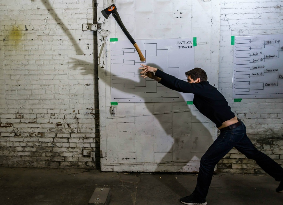 Competitors throw five axes, each round for three rounds. (Nick Kelleher / UBER Events & Promotions)