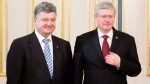 Ukranian President Peter Poroshenko meets with Canadian Prime Minister Stephen Harper several hours after Poroshenko was sworn in Saturday June 7, 2014 in Kyiv, Ukraine.  (Adrian Wyld / THE CANADIAN PRESS)