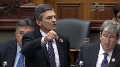 Energy Minister Chris Bentley fires back at opposition attacks in the Ontario legislature on Tuesday, Dec. 6, 2011.