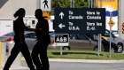 Canadian border guards are silhouetted as they replace each other at an inspection booth at the Douglas border crossing on the Canada-USA border in Surrey, B.C., on Thursday August 20, 2009. THE CANADIAN PRESS/Darryl Dyck