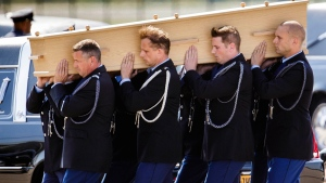 Pallbearers carry remains of MH17 victims