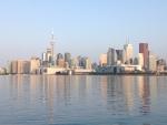 The sun shines over the Toronto skyline on Friday, Aug. 1, 2014. (George Stamou / CTV News)