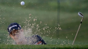 Russell Knox, of Scotland, hits out of the bunker on the first hole during the first round of the PGA Championship golf tournament at Valhalla Golf Club on Thursday, Aug. 7, 2014, in Louisville, Ky. (David J. Phillip/AP)