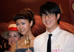 Hong Kong actor Jaycee Chan and actress Fiona Sit react during a premiere of their film 'Break up club' in Hong Kong Monday, June 14, 2010. (AP Photo/Vincent Yu)