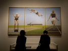 People overlook the art of Alex Colville during a media preview of the largest exhibition of the late Canadian painter's work ever assembled at The Art Gallery of Ontario in Toronto on Tuesday, August 19, 2014. THE CANADIAN PRESS/Nathan Denette