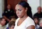 Shayanna Jenkins, fiancee of former New England Patriots NFL football player Aaron Hernandez, arrives at a hearing for Hernandez at Attleboro District Court in Attleboro, Mass on July 24, 2013. (AP / Bizuayehu Tesfaye)
