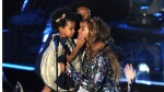 """FILE - In this Sunday, Aug. 24, 2014 file photo, Beyonce on stage hugs Jay Z and their daughter Blue Ivy as she accepts the Video Vanguard Award at the MTV Video Music Awards at The Forum, in Inglewood, Calif. BET has suspended a producer after a joke about Blue Ivy's hair aired Monday, Aug. 25, 2014, on the network's music video countdown show, """"106 & Park."""" A source at the network, who spoke on the condition of anonymity because the person was not allowed to discuss the matter publicly, said the producer was suspended after the ill-fitting joke about Beyonce and Jay Z's two-year-old daughter aired. (Photo by Chris Pizzello/Invision/AP, file)"""