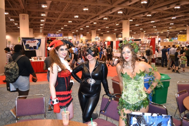 Fans dressed as Harley Quinn, left to right, Catwoman and Poison Ivy pose at Fan Expo Canada, in Toronto, Thursday, Aug. 28, 2014. (Josh Elliot / CTVNews.ca)