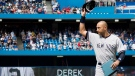 New York Yankees shortstop Derek Jeter acknowledges the crowd while being honoured in an on-field ceremony before his final game at the Rogers Centre in Toronto on Sunday, Aug. 31, 2014. (Darren Calabrese / The Canadian Press)