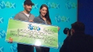 Deanna Bergeron, 30, and her fiance Jeff Bourret, 32, collect their cheque at the OLG Presentation Centre in Toronto on Monday, Sept. 15, 2014.