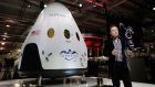 Elon Musk, CEO and CTO of SpaceX, introduces the SpaceX Dragon V2 spaceship at the SpaceX headquarters in Hawthorne, Calif. on May 29, 2014. (AP / Jae C. Hong, file)