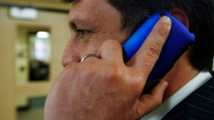 An unidentified man talks on his cell phone on March 2, 2010. (AP / Pat Wellenbach)
