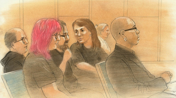 In this image Kelly Pflug-Back, left, of Guelph, Ont., is seen in a Toronto court on Friday, Feb. 24, 2012.