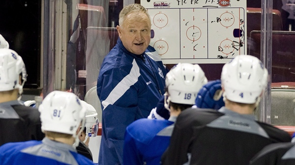 New Toronto Maple Leafs' head coach Randy Carlyle speaks to players during a practice session at the Bell Centre in Montreal, Saturday, March 3, 2012, after his appointment as new head coach of the Toronto Maple Leafs hockey team. THE CANADIAN PRESS/Graham Hughes