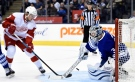 Detroit Red Wings' Justin Abdelkader scores on Toronto Maple Leafs goalie James Reimer in Toronto on Friday, Oct. 17, 2014. (The Canadian Press / Frank Gunn)