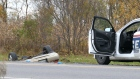 A car is overturned in the ditch in a cordoned off area in Saint-Jean-sur-Richelieu, Que. on Monday Oct. 20, 2014. (Pascal Marchand / THE CANADIAN PRESS)