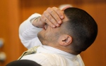 Former New England Patriots football player Aaron Hernandez rubs his eyes during an evidentiary hearing at Bristol County Superior Court, Thursday, Oct. 2, 2014, in Fall River, Mass. (AP Photo/CJ Gunther)