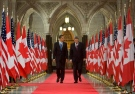 U.S.President Barack Obama and Prime Minister Stephen Harper walk down the Hall of Honour on Parliament Hill in Ottawa, Thursday Feb.19, 2009. (THE CANADIAN PRESS / Tom Hanson)