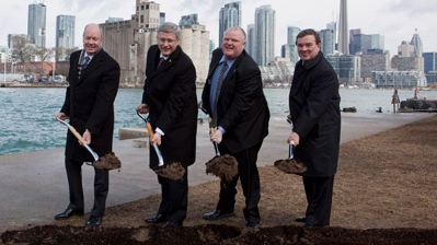 Toronto Port Authority chair Mark McQueen, left to right, Prime Minister Stephen Harper, Toronto Mayor Rob Ford and Finance Minister Jim Flaherty break ground on the construction of a pedestrian tunnel to Billy Bishop airport in Toronto on Friday, March 9, 2012. THE CANADIAN PRESS/Pawel Dwulit