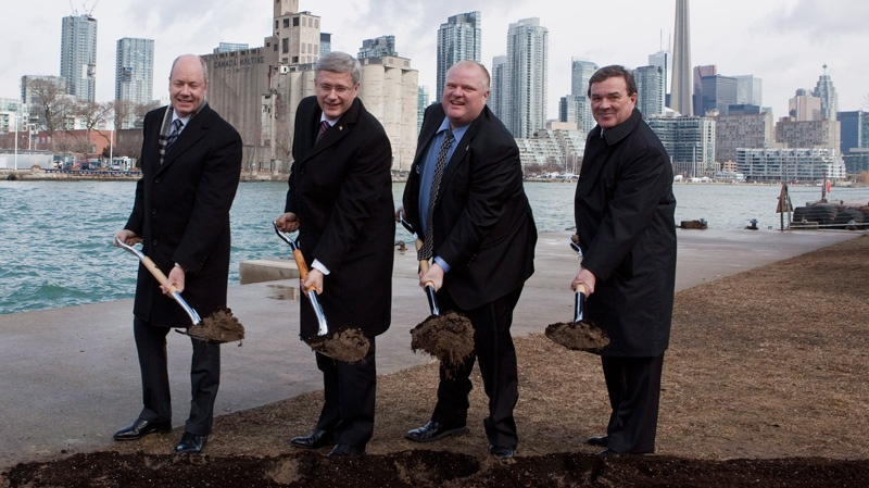 Toronto Port Authority chair Mark McQueen, left to right, Prime Minister Stephen Harper, Toronto Mayor Rob Ford and Finance Minister Jim Flaherty break ground on the construction of a pedestrian tunnel to Billy Bishop Airport in Toronto on Friday, March 9, 2012. (Pawel Dwulit / THE CANADIAN PRESS)