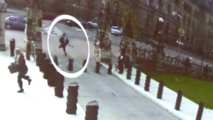 Michael Zehaf-Bibeau is shown carrying a gun while running towards Parliament Hill in Ottawa on Wednesday, Oct. 22, 2014, in a still taken from video surveillance in this handout photo. (RCMP handout)