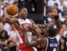 Toronto Raptors forward DeMar DeRozan, left, battles for the ball against Atlanta Hawks forward Paul Millsap, right, during first half NBA basketball action in Toronto on Wednesday, October 29, 2014. THE CANADIAN PRESS/Nathan Denette