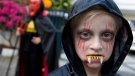 A young boy dressed for Halloween prepares to trick-or-treat in a housing compound in South Jakarta district in Jakarta, Indonesia, Friday, Oct. 31, 2014. (AP / Mark Baker)