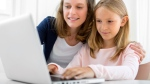 Tech firms are launching initiatives to encourage girls to get involved in computer science. (Production Perig/Shutterstock.com)