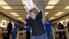 Lukas from Germany is the first to get the new iPad at the Apple store in a shopping mall in Oberhausen, western Germany, Friday, March 16, 2012. (AP / Martin Meissner)