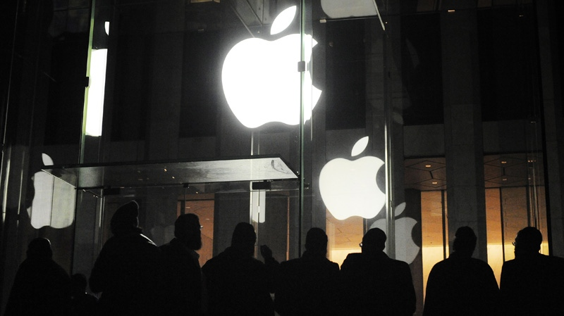 People gather outside an Apple retail store on Fifth Avenue in the Manhattan borough of New York, Friday, March 16, 2012, as they wait for the 8 a.m. local time release of the new iPad tablet. (AP / Jeffrey Furticella)