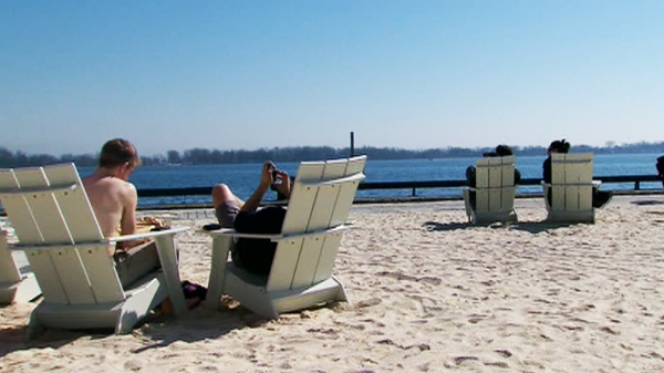 Residents enjoy the first official day of spring in Toronto on Tuesday. March 20, 2012.