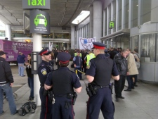 Police keep a close eye on Air Canada workers shortly before they were ordered to headed back to work at Pearson International Airport, Friday, March 23, 2012. (CTV News)
