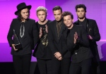 Harry Styles, from left, Niall Horan, Liam Payne, Louis Tomlinson and Zayn Malik of the musical group One Direction accept the award for pop/rock band, duo or group on stage at the 42nd annual American Music Awards at Nokia Theatre L.A. Live on Sunday, Nov. 23, 2014, in Los Angeles. (Invision /  Matt Sayles)