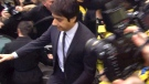Jian Ghomeshi is escorted by police as he leaves an Ontario Court of Justice courthouse, in Toronto, on Wednesday, Nov. 26, 2014.