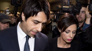 Former CBC radio host Jian Ghomeshi makes his way through a mob of media with his lawyer Marie Henein at a Toronto court, Wednesday, Nov. 26, 2014. (Nathan Denette / THE CANADIAN PRESS)