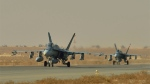 Royal Canadian Air Force CF-18 fighter jets taxi on the runway in Kuwait during Operation IMPACT on November 13, 2014. (Canadian Forces Combat Camera / DND)