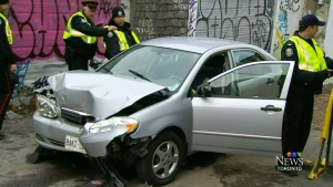 Police say a Toyota Camry was travelling northbound in an alleyway, located near the College Street and Euclid Avenue area, when it crashed into the back wall of a building at approximately 2:30 p.m.