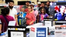 Customers stand in line as they wait to receive a television during Black Friday sales at Best Buy in McAllen, Texas on Thursday Nov. 27, 2014. <br> <br> (The Monitor / Gabe Hernandez)