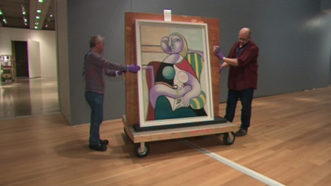 AGO staff prepare Picasso paintings on Tuesday, April 3, 2012.