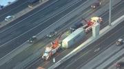 Extended: Truck's trailer stuck on QEW guardrail